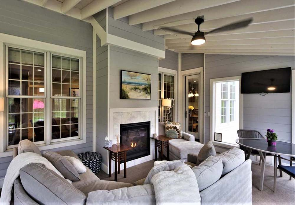 Sunroom with fireplace and large couch