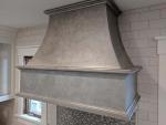 Custom weathered metal finish on wood stove hood