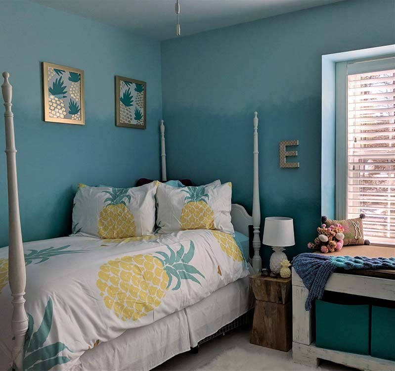 Teal bedroom walls with bed