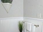 Bathroom with stencil design on wall