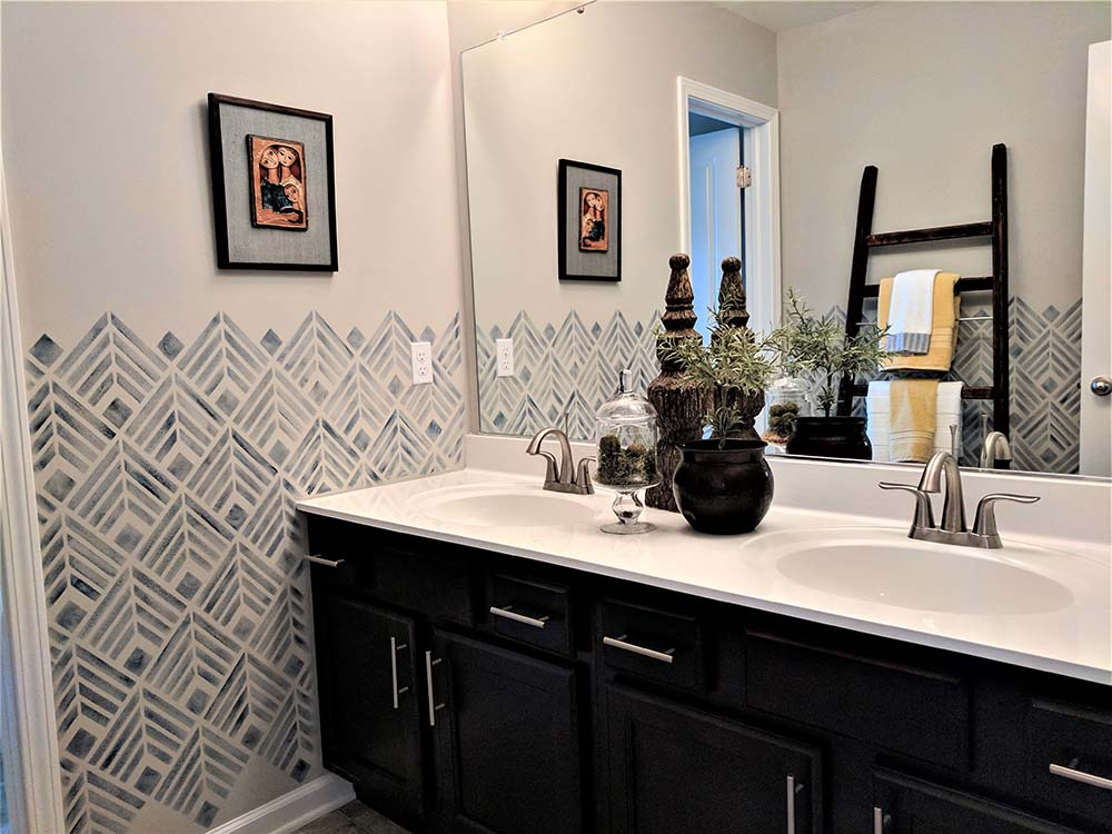 blue stencil design on bathroom wall