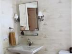 Stenciled wall in bathroom