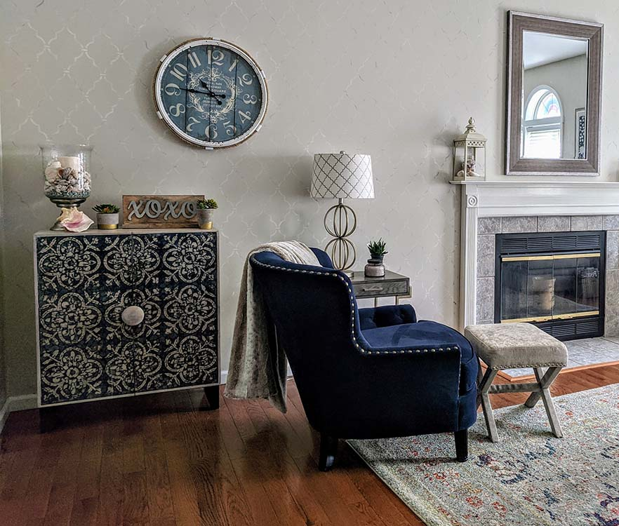 Living Room with fireplace, and blue chair and stenciled wall